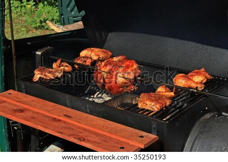 Cooking a rotisserie chicken on the grill