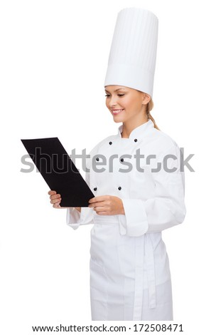 cooking, advertisement and food concept - smiling female chef with blank black paper - stock photo