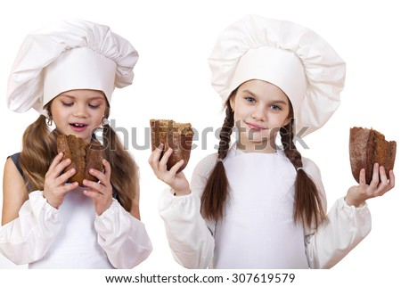 Cooking and Children concept - Two smiling little girls in cook hat, isolated on white background - stock photo