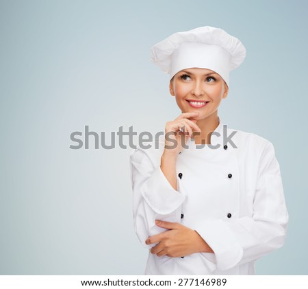 cooking and food concept - smiling female chef, cook or baker dreaming over gray background - stock photo