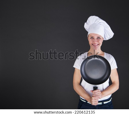 cooking and food concept - smiling female chef, cook or baker with pan