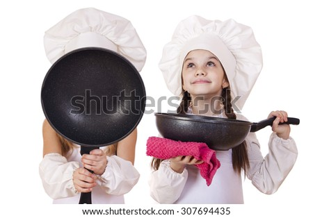 Cooking and people concept - Two Little girls in a white apron, isolated on white background - stock photo