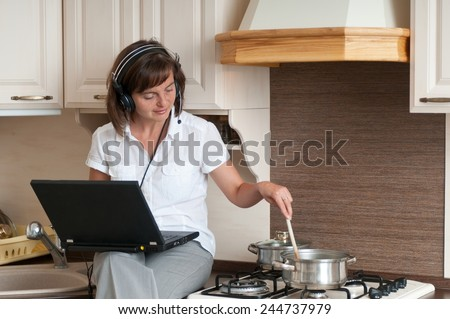 Cooking and working from home - stock photo