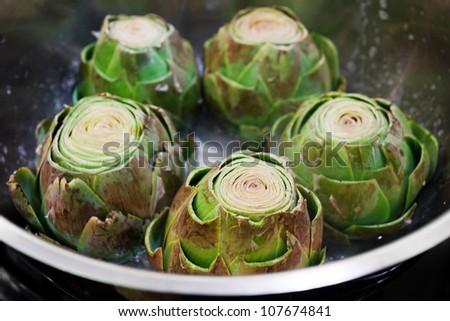 Cooking artichokes, closeup - stock photo