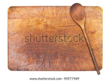 Cooking background - wooden spoon on cutting board isolated on white background