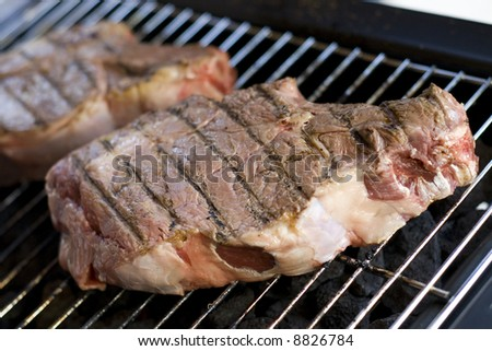 Cooking barbecue steak