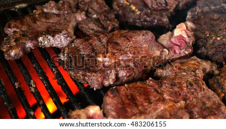 Cooking barbecue steak on the hot grill