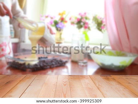 Cooking berry pie, blurred kitchen with wooden background