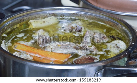 Cooking chicken soup. - stock photo
