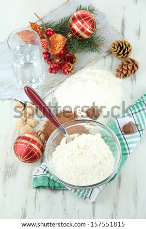 Cooking Christmas cookies on wooden table - stock photo