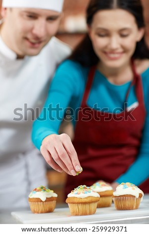 cooking class, culinary, bakery, food and people concept - happy group of woman and male chef cook baking in kitchen - stock photo