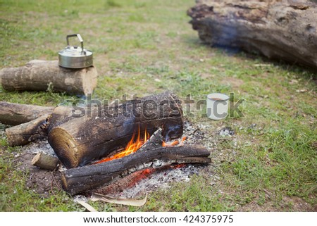Cooking coffee over an open fire in the forest.