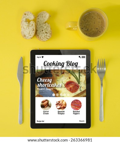 cooking concept: hipster breakfast with cooking blog app on a tablet screen - stock photo