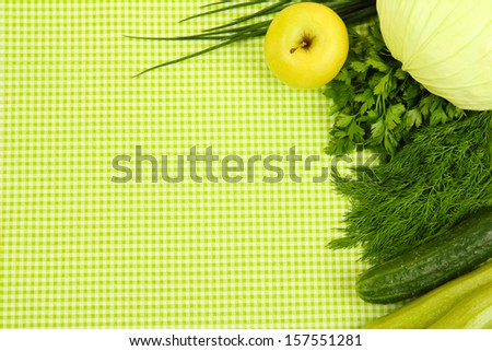 Cooking concept. Vegetables on tablecloth background - stock photo