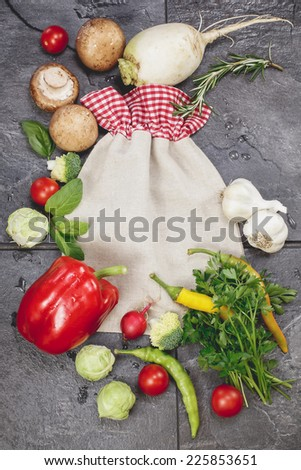 Cooking  concept with seasonal  vegetables. Vegetables and spices vintage border and vegetable storage bag. Cooking concept. Copy space composition