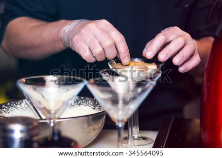 cooking dessert in a glass on the background of the bar