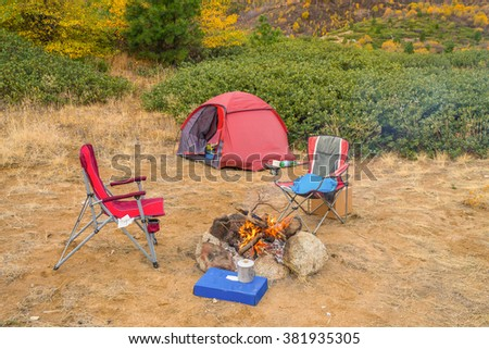 cooking dinner around the campfire near the red tent,  Mountain Home Road, LEAVENWORTH AREA, Washington state - stock photo