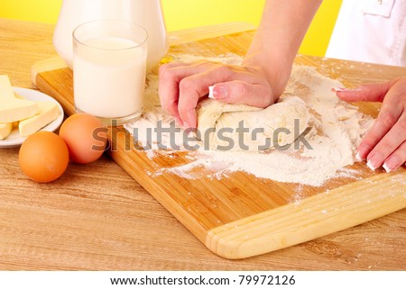 cooking dough on brown background - stock photo