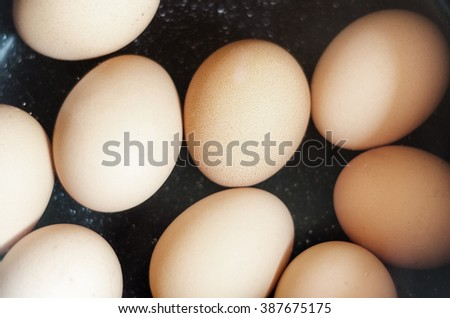 Cooking eggs in water - stock photo