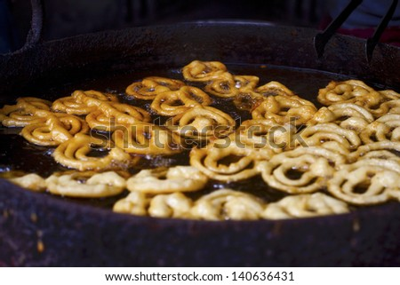 Cooking famous Indian sweet jalebi - stock photo