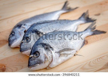 Cooking fish on the grill - stock photo