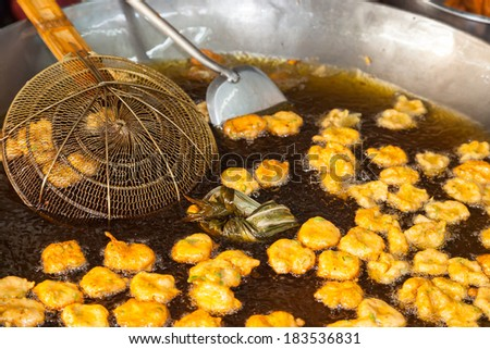 Cooking fish-paste balls in Thailand street market - stock photo