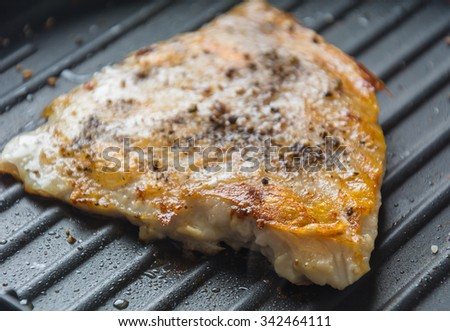 cooking fish Steak on frying pan - stock photo