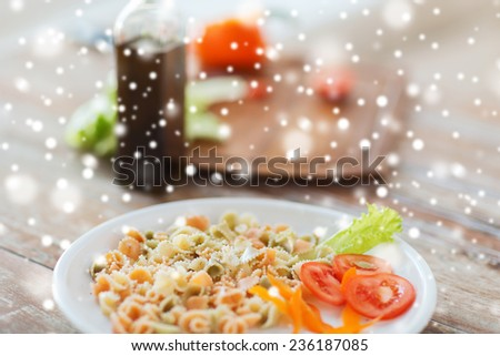 cooking, food and home concept - close up of pasta meal on plate - stock photo