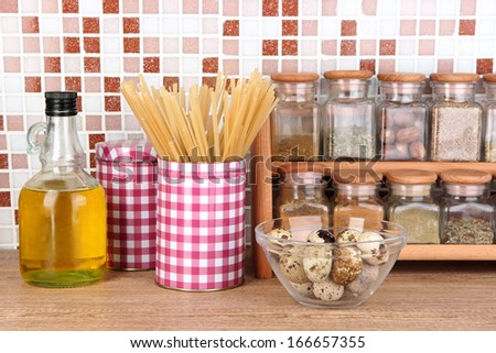 Cooking food in kitchen on table on mosaic tiles background - stock photo