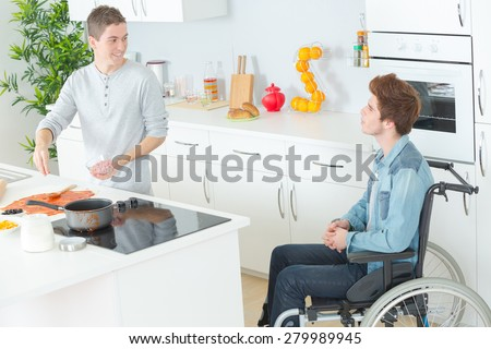 Cooking for a disabled friend - stock photo
