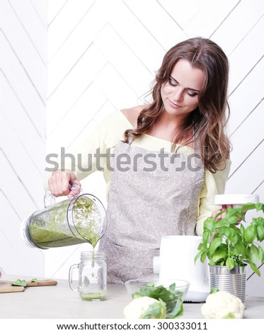 Cooking frame. Beautiful woman in the kitchen - stock photo