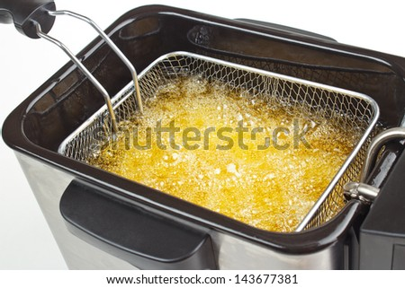 Cooking french fries in deep fryer - stock photo