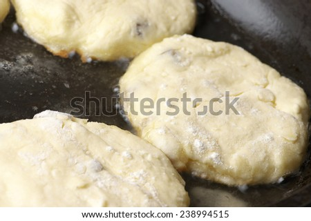 Cooking: frying cottage cheese pancakes.