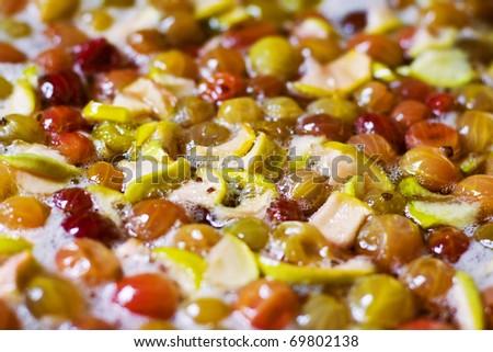 Cooking gooseberry jam - stock photo
