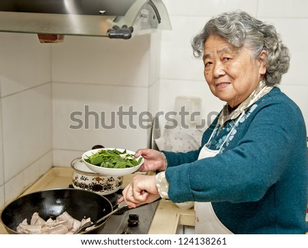 cooking grandmother - stock photo