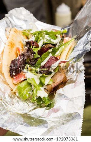 Cooking Greek gyros at the Farmers Market. - stock photo