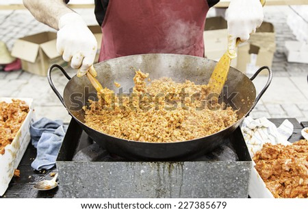 Cooking ground beef, detail of a chef preparing red meat - stock photo