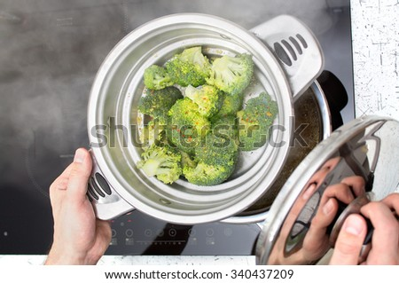 Cooking healthy food using steam pot - stock photo