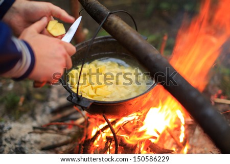 cooking in a pot on the fire - stock photo