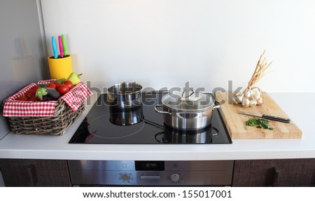cooking in modern kitchen - stock photo