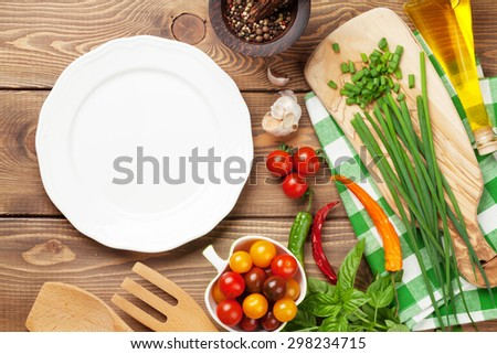 Cooking ingredients and empty plate for copy space. Top view - stock photo