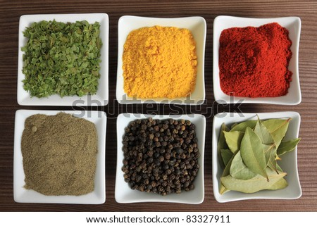 Cooking ingredients - herbs and spices. Food additives: ramsons, pepper, turmeric and bay laurel leaves. - stock photo