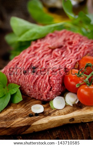 Cooking ingredients. Minced meat with tomato and spring onions. - stock photo