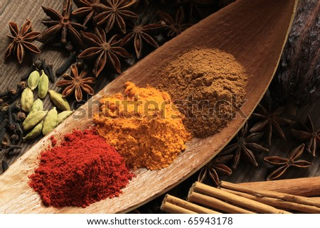 Cooking ingredients - warm colours of herbs and spices. - stock photo