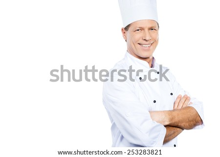 Cooking is my passion. Confident mature chef in white uniform keeping arms crossed and smiling while standing against white background - stock photo