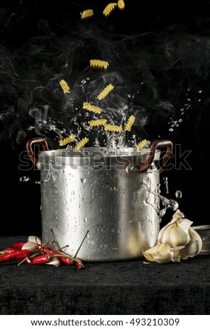 cooking italian pasta in boiling water