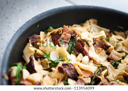 Cooking italian tagliatelle - stock photo