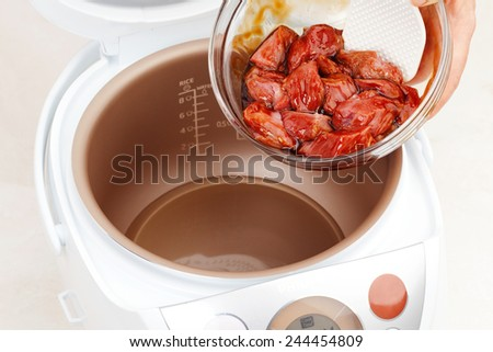 cooking meat in a sauce in Multicooker closeup - stock photo