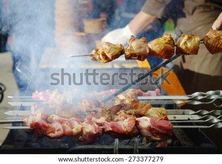 cooking meat over a fire in the restaurant - stock photo