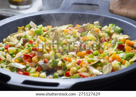 Cooking Mediterranean vegetables on a pan
